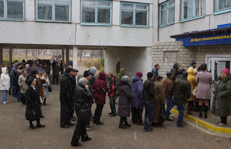 ' Donetsk citizens queuing outside one of the polling stations during the elections '