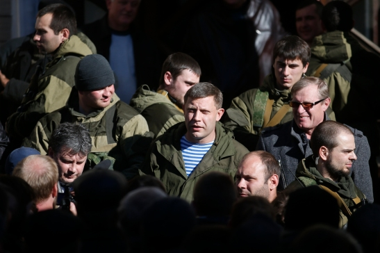'Donetsk militia commander and prime minister of the 'Donetsk People's Republic' Alexander Zakharchenko, center, visits a coal mine October 29 as he campaigns to be elected head of state. (Reuters/Maxim Zmeyev) '